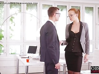 Hot babe Belle Claire rides her bosses hard cock in the offi