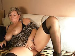 short haired german mature with big tits on her webcam