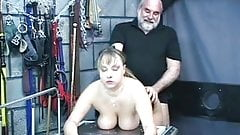 Busty slave sucks her master's cock in the torture room