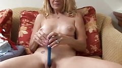 Horny blonde MILF shows off the sexy piercing on her pussy