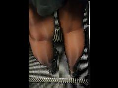 Shiny black pantyhose girl with mini skirt
