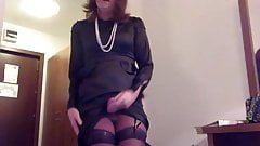 Transvestite masturbation in satin dress