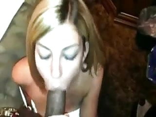 Her mouth gets filled with black rod