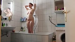 nice girl shaves in the shower