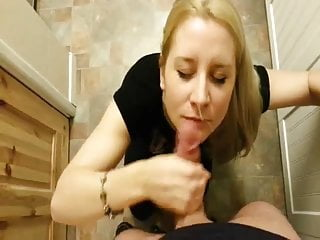 Blonde wife giving a blowjob in the kitchen