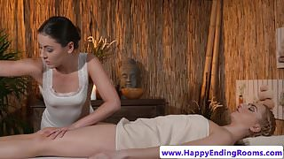 Oiled euro babe fingered by lesbian masseuse