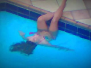 Woman Playing with Pool Jet