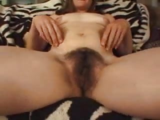 Young hairy girl without boyfriend shows her pussy