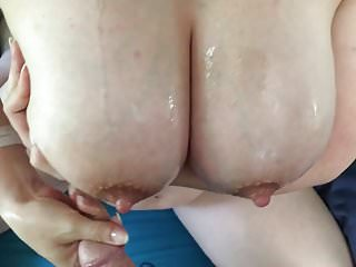 She strokes my cum all over her tits