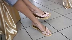Incredible long feet and toes in very cute cork flip-flops.