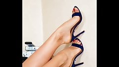 Beautiful feet in blue sandals and red enamel