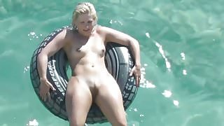 Nudist girl floats