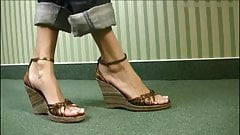 Incredible long feet and toes in very cute wedge sandals.'s Thumb
