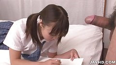 Pretty school girl Momoka Rin examines and sucks a dick