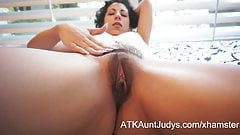 Kinky Gaga is enjoying rubbing lotion on her hairy pussy
