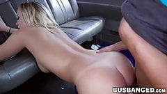 Busty babe fucks young nerds cock during a van ride