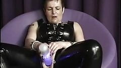 Pierced mature in latex fucks her cunt