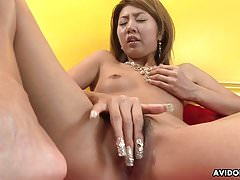 Flat chested Asian toys her bushy slit for the camera