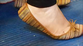 Latina girl's flexible arch of her feet in flats.