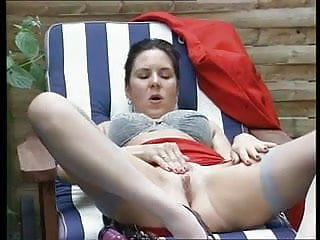 German mature silke fucks herself outdoor