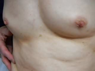 wife's small tits and spread hairy pussy and swollen clit