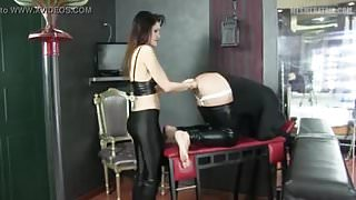 DDT pegs a slave on the wall