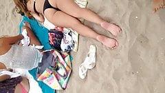 Black thong laying down on beach