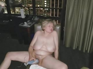 Mature masturbation in front of open hotel window