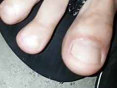 MY TOES IN AN UNDERGROUND PUBLIC CAR PARK