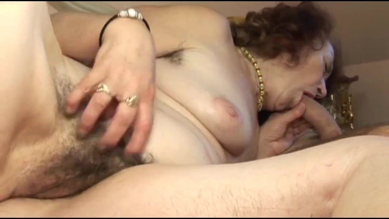 Woman giving man handjob