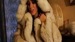 Brunette in white fur coat playing with herself