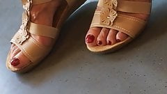 Hidden granny toes and feet on train