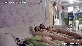 Couple watching tv while being naked
