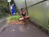 sexy girl power pissing public flashing at bus stop