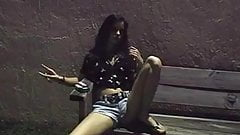 Teen smokes cigarette outside and flashes pussy