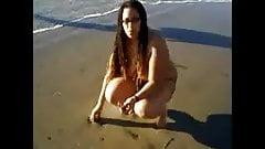 Black Nudist Naked on the Beach's Thumb