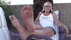 Hot mature shows her soles