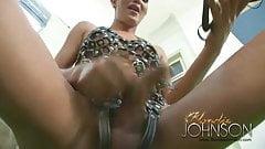 Blondie Johnson in leather straps
