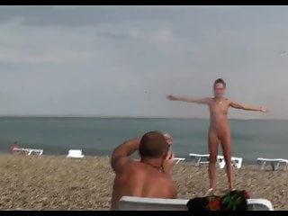 Asian girls posing - Voyeur on public beach. girls posing