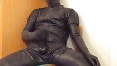 Masturbating in rubber catsuit