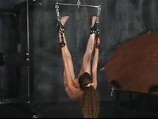 Cute young brunette is tortured in the bdsm sex dungeon by older man