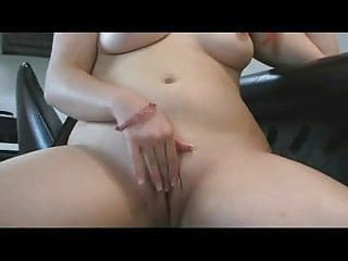 Chubby Redhead showing her Tits and playing with her Pussy