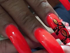 Latina with sexy long orange(different design) nails 's Thumb