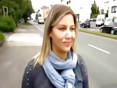 Blonde woman walking by the road with a cumshot on her face