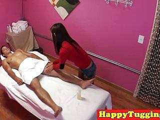 Petite asian masseuse jerking clients cock