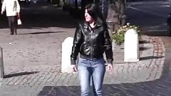 Daring jeans peeing while walking on the street 2