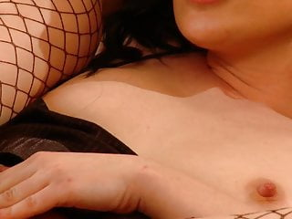 Hot bitch in fishnets slides on hard cock with her ass