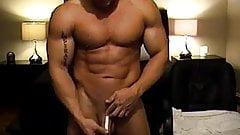 A  hot bald tattood guy wanking his  big cock and cumming