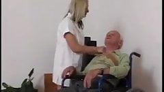 Young nurse takes care of grandpa