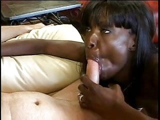 Preview 6 of Dark black chick sucks big white cock